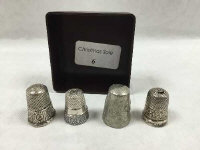 A silver thimble, London 1892, together with other thimbles. (4)