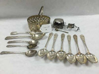 A Continental white metal miniature sleigh with figures, indistinctly marked, length 12 cm, 45.9g, together with a white metal pierced basket, six silver spoons and a set of six Victorian tea spoons. (13)