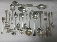 A set of six silver teaspoons, London 1803, together with  fourteen further items of cutlery and a silver napkin ring, 842.4g, 27 troy ounces. (21)