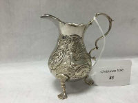 A silver cream jug, with deer decoration to the sides, London marks indistinct, height 9.5 cm, 84g.