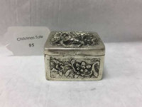 A Continental silver box, with flower and dragon decoration, stamped 825, 5 cm x 5 cm, 71.3g.