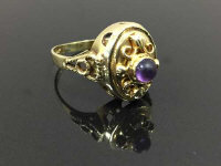 A 14ct gold classical style ring set with a cabochon amethyst, 5.6g, size Q.