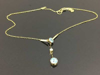 A 15ct gold seed pearl and aquamarine pendant on chain, 3.7g.