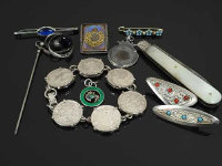 A Charles Horner silver hat pin, together with a silver an enamelled thistle pendant of the same manufacture and eight further items of collectable interest. (10)
