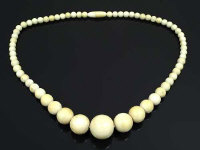 A nineteenth century graduated ivory bead necklace, length 46 cm.