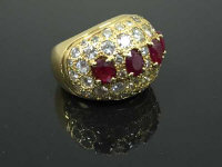 An 18ct gold Gentleman's diamond encrusted ruby ring, set with four mixed cut rubies, measuring 5.8mm x 4.8mm, each stone set portrait style by yellow claws, head completed by fifty-two round faceted diamonds, including round brilliant and eight cut styles, estimated diamond weight 4.5ct, clarity VS-SI, colours G/H/ to J/K.