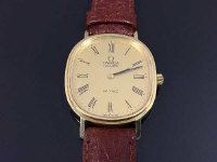 An 18ct gold Omega De Ville Gentleman's wrist watch, on leather strap.