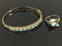 A 9ct gold opal and diamond bracelet, diameter 6 cm x 5.6 cm, together with a 9ct opal and diamond ring, size O/P. (2)