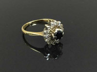 An 18ct gold diamond and sapphire cluster ring, size J.