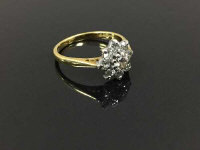 An 18ct gold nine stone diamond flower cluster ring, size I/J.