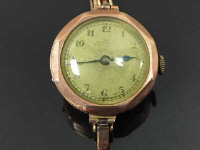 A 9ct gold Lady's wrist watch, on expansion strap, 18.1g.