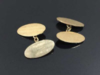 A pair of 9ct gold oval cufflinks, 10.2g. (2)