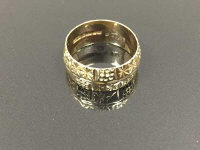 A 9ct gold textured band ring, 4.4g, size N.