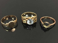 A yellow metal ring, marked .583, set with a clear stone, size  O, together with two 9ct gold rings. (3)