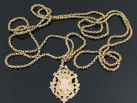 A 9ct gold muff chain with 9ct gold fob, length 75.5 cm, 48.7g.