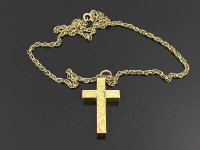 A 9ct gold necklace, 8.5g, together with a yellow metal crucifix pendant. (2)