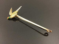 A 15ct gold bar brooch with enamelled pheasant terminal, length 62 mm, 4.6g.