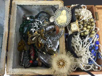 A collection of vintage costume jewellery, wrist watches etc, contained within two boxes. (Q)