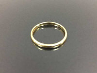 An 18ct gold band ring, 1.5g. size L/M.