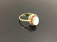 An 18ct gold opal cluster ring, size N/O.
