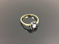 An 18ct gold opal cluster ring, size O.