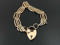 A 9ct gold gate bracelet with heart clasp, 13.4g.