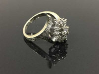 A 14ct gold diamond cluster ring, with textured shank, size M.