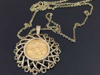 A 9ct gold mounted sovereign dated 1912, hanging upon a 9ct gold chain, 22.1g.