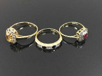 Three 9ct gold dress rings set with gemstones, 5.3g. (3)