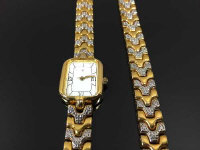 A gold-tone wrist watch with matching bracelet. (2)