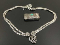 A money clip with silver front, together with a celtic style necklace. (2)