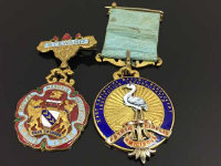 Two gilt metal and enamel masonic medals, together with apron collar.