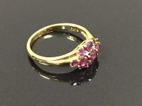 A 9ct gold diamond set cluster ring with purple gemstones, 3.2g, size R/S.