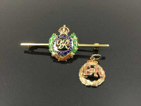 A 14ct gold Royal Engineers enamelled bar brooch, 4.9g, width 5 cm, together with a 9ct gold Elizabeth II enamalled pendant, 1.7g. (2)