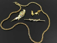 A gold plated rope twist necklace, together with parrot brooch, bar brooch etc.