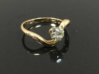 A single stone diamond ring mounted in yellow gold, size J.