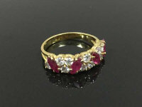 An 18ct gold ruby and diamond ring, size M.