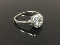 An old cut diamond ring with diamond surround, approximately 1ct, size O.