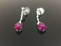 A pair of cabochon ruby and diamond earrings in white gold. (2)