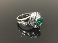 An 18ct white gold emerald and diamond cluster ring, size M.