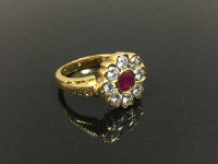 A 22ct gold ruby and diamond cluster ring, size M/N.