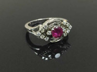 An 18ct white gold ruby and diamond ring, size M.