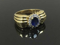A 14ct gold sapphire and diamond ring, size P.