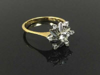 An 18ct gold diamond cluster ring, size N.