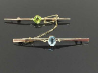 Two 9ct gold stick pins set with gemstones, 5g. (2)