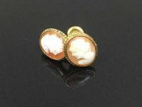 A pair of 9ct gold cameo earrings. (2)