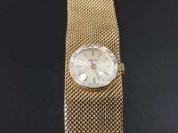 An 18ct gold Longines Lady's wrist watch, 45.3g, with original retail guarantee.