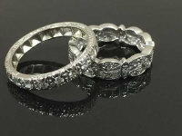 A platinum diamond eternity ring together with an 18ct white gold half eternity ring. (2)