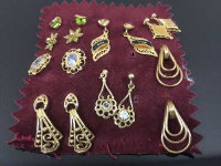 A collection of eight pairs of gold earrings. (16)