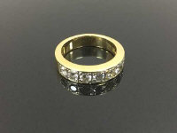 An 18ct gold seven stone diamond half eternity ring, approximately 0.85ct, size N.
